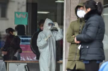 Asian markets fall as WHO mulls declaring global virus emergency