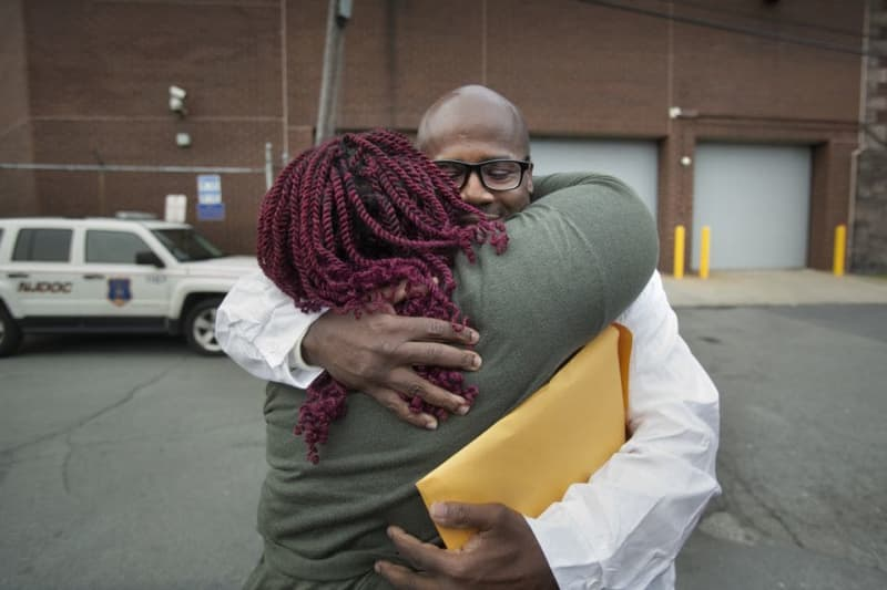 One unreliable witness put two men behind bars for 25 years. Now they're 'finally, finally' free.